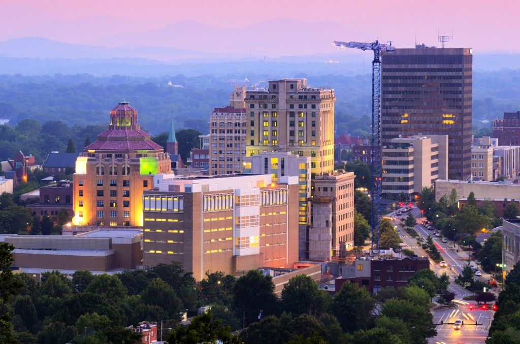 Asheville, North Carolina skyline nestled in the Blue Ridge Mountains.